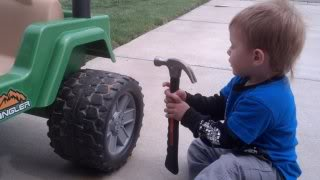 little boy claw hammer toy.jpg